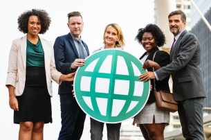 five men and women holding logo